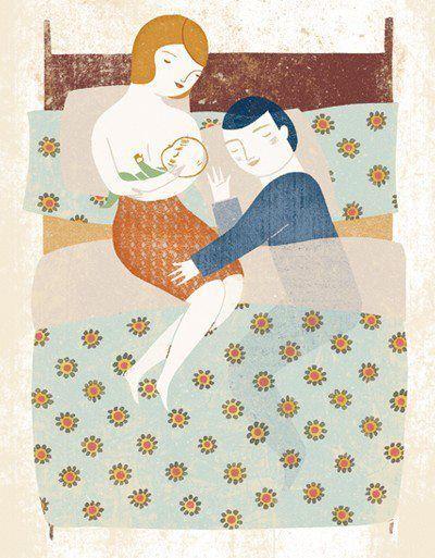 pais com bebés na cama